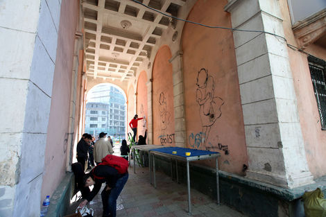 <p>While in town for the sculpture unveiling, FAILE worked with local Mongolian artists on a mural. They stenciled an image of a young girl clutching a skateboard – a nod to the quickly modernizing nature of Mongolia contrasted by its vast unpaved landscape – on the wall of an archway located in the central university district of Ulan Bator. Each Mongolian artist worked on customizing the girl's dress in their own style. The emerging Mongolian artists are recent finalists of the Tiger Translate Festival and were selected by a prestigious panel of judges that included the National Arts Council.</p>